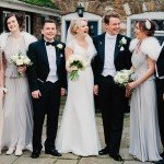 wedding group photo flowers dress