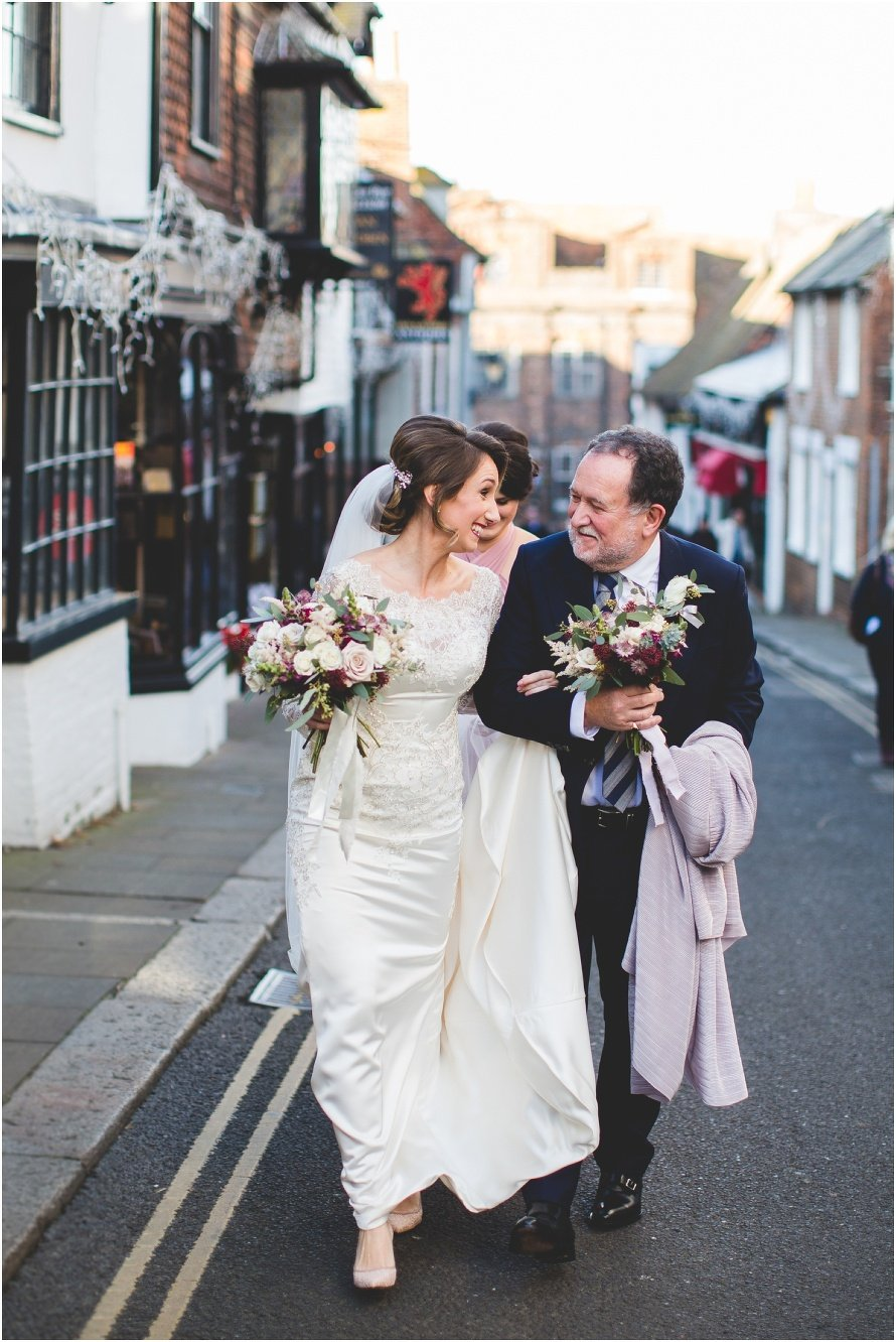 bride and father of bride walking in Rye
