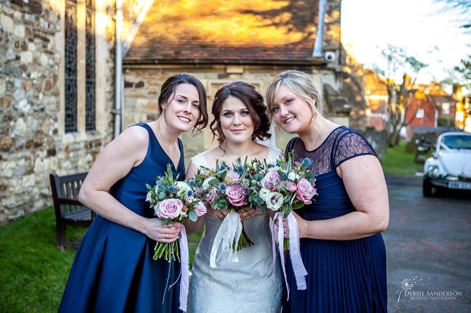 bride and bridesmaids with bouquet