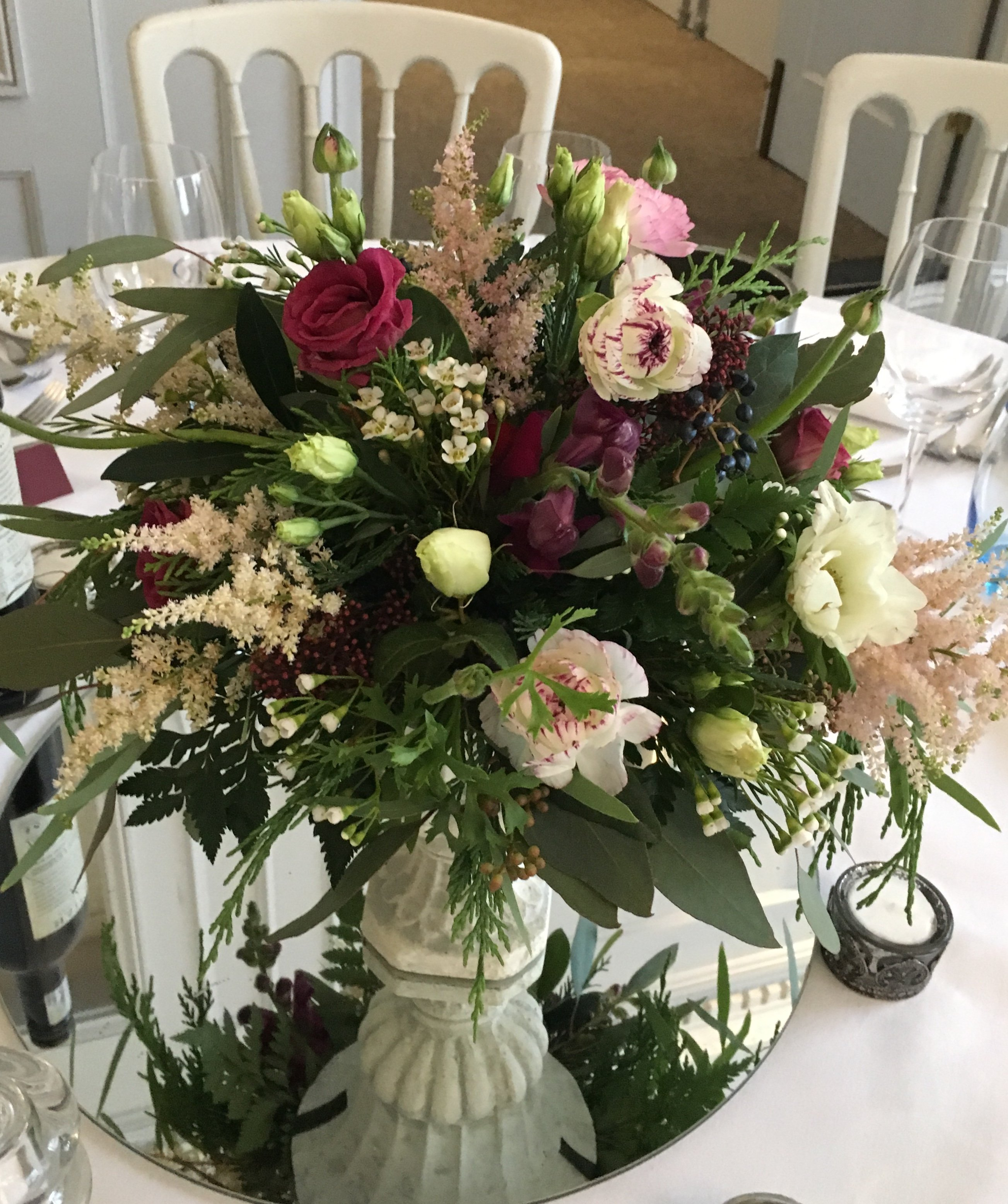 wedding table flowers in urn